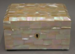 An early 20th century mother-of-pearl box.