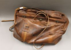 A large Victorian leather Gladstone bag stamped Perry & Perry Makers, 26 Duke St, Piccadilly,