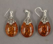 A pair of dress earrings, together with matching pendant. The latter 3.75 cm high.