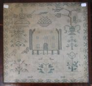 A Victorian sampler worked with a house, dated 1840, framed and glazed. 44 x 41 cm.