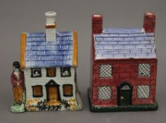 Two Staffordshire cottage form money boxes