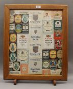 A Cambridge College beer mat fire screen. 51.5 cm wide.