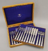 A canteen of silver plated fish cutlery. 35 cm wide.