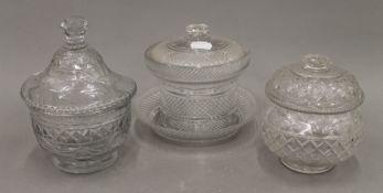 Three 19th century cut glass lidded bon bon dishes. The largest 16 cm high.