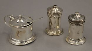 A cased three-piece silver cruet set.