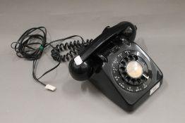 A vintage black bakelite GPO telephone (in working order)