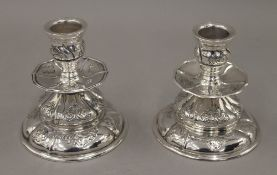A pair of Danish silver candlesticks, makers mark AD. 9 cm high. 9.6 troy ounces.
