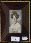 A 19th century miniature on ivory of a young lady, framed and glazed. 13 x 18 cm overall.