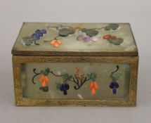 A 19th century Chinese coral and hardstone set jade box. 12.5 cm wide.