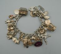 A silver charm bracelet. 88.1 grammes total weight.