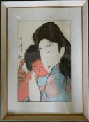 A Japanese woodblock print of two figures, framed and glazed. 24 x 36.5 cm.