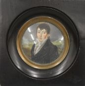 A 19th century miniature on ivory of a young gentleman in a mountainous landscape,