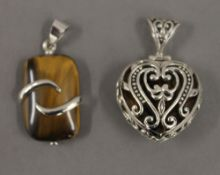 Two silver dress pendants. Each 2.5 cm high.