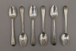 A set of six Georgian bright cut silver teaspoons. 61.2 grammes.