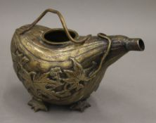 A 19th century bronze pouring vessel formed as a gourd. 18 cm long.