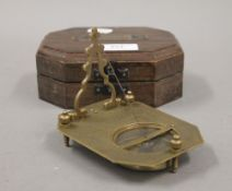 A boxed sundial compass. The boxed 14 cm wide.