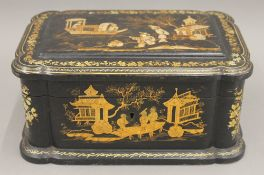 A 19th century chinoiserie lacquered box. 21 cm wide.