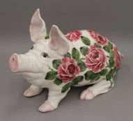 A Wemyss Ware Cabbage Roses pattern pig by Esther Weeks, stamped 1988. 43 cm long.