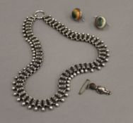 A Victorian silver necklace, a pair of earrings and a silver Fumsup charm. The latter 3 cm high.