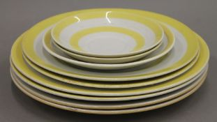 A quantity of T G Green yellow and white porcelain plates. The largest 25 cm diameter.