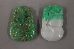 Two jade pendants. The largest 5 cm high.
