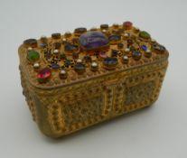 A 19th century Austrian gem set gilt box. 9.5 cm wide.