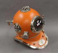 An orange replica divers helmet. 41 cm high.