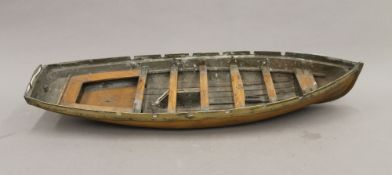 A Scratch Built brass and wooden boat hull. 57 cm long.