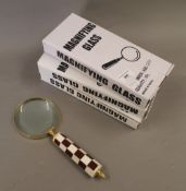 Three boxed magnifying glasses