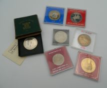 Seven cased medallions and coins