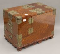 A late 19th/early 20th century Chinese brass mounted 'zebrawood' style gentleman's travelling
