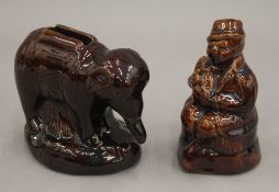 Two 19th century treacle glazed money boxes, one formed as an elephant, 11 cm long.