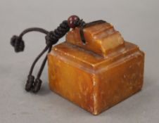 A Chinese square soapstone seal. 5.5 cm high.