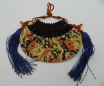 A Chinese embroidered purse. 13 cm wide.