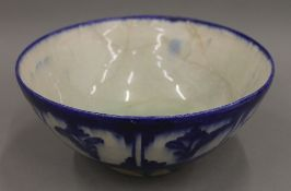 An antique Persian blue and white pottery bowl. 22 cm diameter.