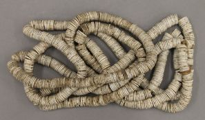 A rare Polynesian shell necklace. Approximately 66 cm long.
