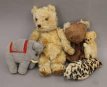A collection of vintage cuddly toys. The largest 30 cm high.