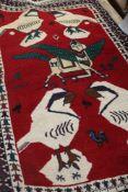 An Eastern wool rug. 88 cm wide.
