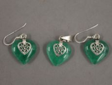 A pair silver mounted heart shaped earrings and matching pendant. The pendant 2 cm high.
