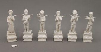 A set of six Continental porcelain cherubs. Each approximately 13 cm high.