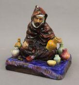 A Doulton porcelain figure, The Potter, HN1493. 17 cm high.