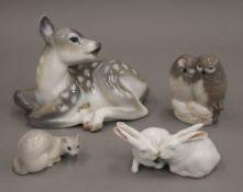 Four Copenhagen porcelain animals. The largest 15.5 cm long.