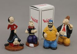 Four Wade Popeye figurines, one boxed.