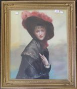 An oil on canvas, portrait of a young lady in a feathered hat, framed and glazed. 48 x 58 cm.