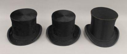 Three top hats, one folding.