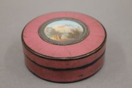 An 18th century circular snuff box, lid inset with a miniature. 7.5 cm diameter.