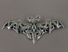 A silver plique a jour bat form brooch. 8 cm wide.