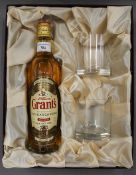 A boxed presentation set containing a bottle of William Grant's Family Reserve Finest Scotch Whisky