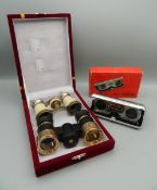 Three pairs of opera glasses/pocket binoculars.
