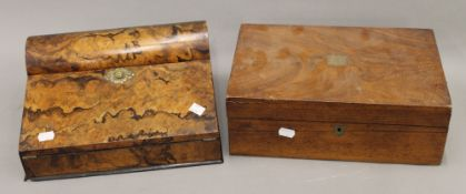 Two Victorian walnut writing slopes. The largest 35 cm wide.